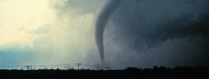 a tornado touching down, shown from afar