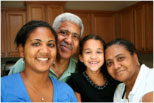 close up portrait of a family of four in a kitchen